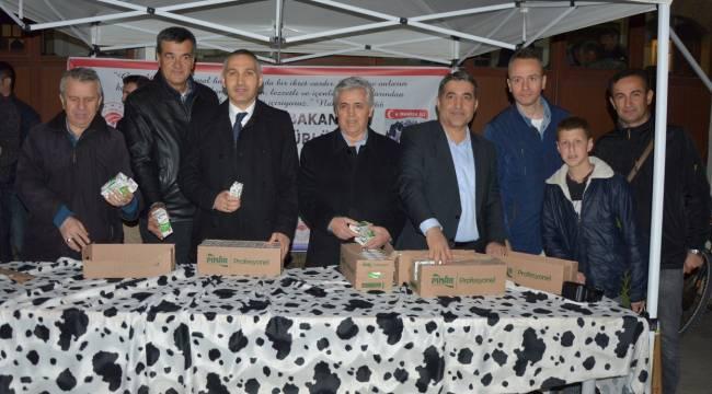 750 fidan ve 400 paket süt dağıtıldı